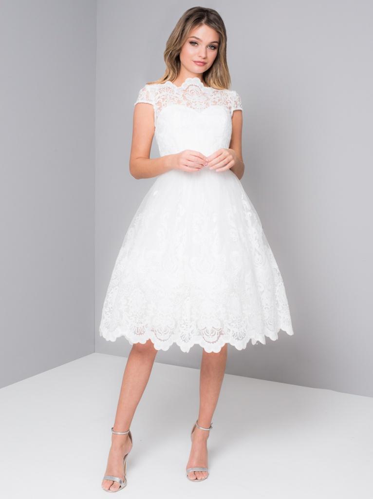 89b8c4c12a57 Biele midi čipkované šaty s krátkym rukávom 199C - Salón Emily