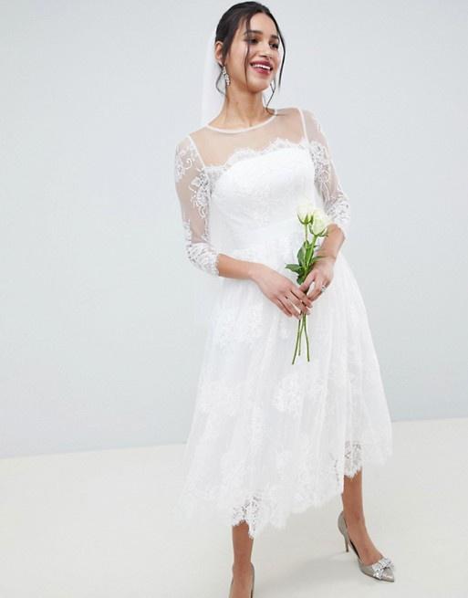 3a49b0703288 Biele midi čipkované šaty s 3 4 rukávom 201A - Salón Emily