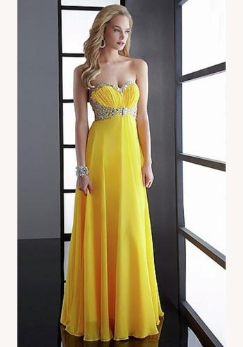 8bddc5c1b11e Žlté dlhé korzetové šaty s kamienkami 257