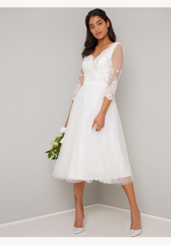 c89365c9c54d Biele midi svadobné vyšívané šaty s kvetovanou potlačou s 3 4 rukávom 314C